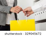 girl with purchases in paper... | Shutterstock . vector #329045672