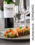 prawns served on lentils | Shutterstock . vector #329060402