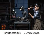 young boy mechanic repairing... | Shutterstock . vector #329093036