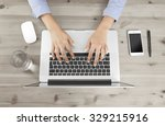 female fingers typing on a... | Shutterstock . vector #329215916