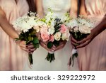 Bridesmaid With Flowers At The...