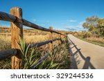 Wooden Fence With A Shadow And...