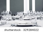 Glasses And Plates On Table In...