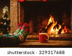 feet in woollen socks by the... | Shutterstock . vector #329317688