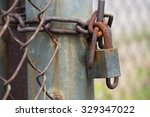 Rusty Old Lock With Rusty Chain....