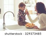 mother with her baby eating... | Shutterstock . vector #329373485