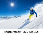 skier skiing downhill in high... | Shutterstock . vector #329436365