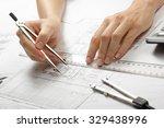 Architect Working On Blueprint...