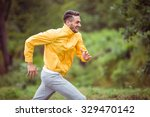 Happy Man Running On A Hike In...