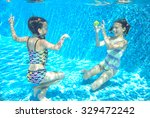 happy children swim in pool... | Shutterstock . vector #329472242