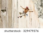 rock climber jump may very well ... | Shutterstock . vector #329479376