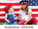 two cute kids eating suckers... | Shutterstock . vector #32962282