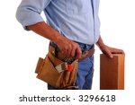 Carpenter wearing a toolbelt with hand on wood beam, isolated over white - stock photo