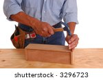 Carpenter setting small nail in wood project isolated over white - stock photo