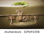 old green suitcase with handle... | Shutterstock . vector #329692358