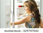 woman wearing colorful dress in ... | Shutterstock . vector #329747042