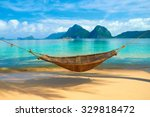a hammock at the beach with the ... | Shutterstock . vector #329818472