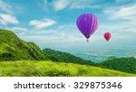 balloon on mountain background | Shutterstock . vector #329875346