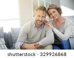 mature couple relaxing in couch ... | Shutterstock . vector #329926868