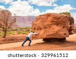 Small photo of Girl pushing stone, impossible concept