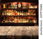 Small photo of wooden table place bar and space for you