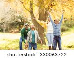 young smiling family throwing... | Shutterstock . vector #330063722