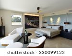 Beautiful modern furniture in a master bedroom suite - stock photo