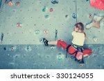 Little Girl Climbing A Rock...