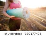 woman walking with a yoga mat... | Shutterstock . vector #330177476
