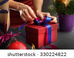 gift wrapping. woman packs... | Shutterstock . vector #330224822