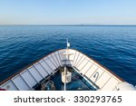 Ship in open sea is showing the bow in a summer day - stock photo