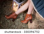 woman's legs  lantern and hay | Shutterstock . vector #330396752
