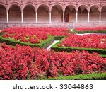 Cloister and flowers, Certosa di Pavia, Italy - stock photo