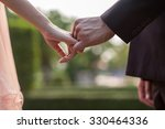 close up of couple holding hands | Shutterstock . vector #330464336