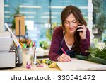 female florist using mobile... | Shutterstock . vector #330541472