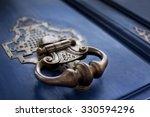 detail of a bronze knocker on a ... | Shutterstock . vector #330594296