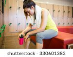 tired woman after a workout in... | Shutterstock . vector #330601382