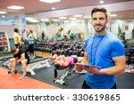 handsome trainer using tablet... | Shutterstock . vector #330619865