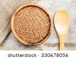 bowl with buckwheat on a wooden ... | Shutterstock . vector #330678056