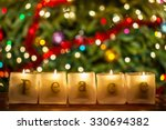 burning candles spelling the... | Shutterstock . vector #330694382