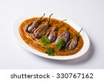 Small photo of Egg Plant Curry or Brinjal Masala also known as Baigan ki sabzi in India, spicy and tasty dish usually served with chapati. selective focus