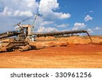 Open Coal Mining Pit With Heav...