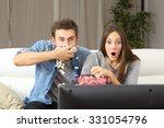 Amazed Couple Watching Tv...
