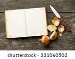 blank recipe book and halved onion - stock photo