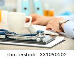 doctor working at table in... | Shutterstock . vector #331090502