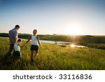 happy family at sunset | Shutterstock . vector #33116836