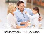 loving parents. cheerful... | Shutterstock . vector #331299356