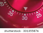 Small photo of Closeup Of A Kitchen Egg Timer - 30 Minutes