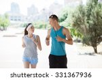 couple jogging in park at... | Shutterstock . vector #331367936
