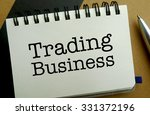 Trading business memo written on a notebook with pen - stock photo
